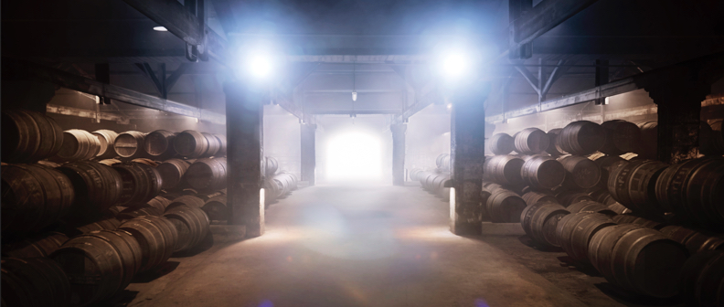 "Surrounded by rows of oak casks in an aroma-filled, semi-darkened cellar… Discover the art of ageing cognac in an authentic working cellar, its walls blackened by the evaporation of the eaux-de-vie, known as the ""angel's share""."